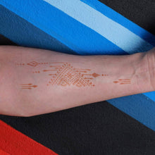 Load image into Gallery viewer, Ruma - Triangle and arrow henna tattoo on forearm