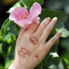 Load image into Gallery viewer, Sun - evil eye henna tattoos on hand