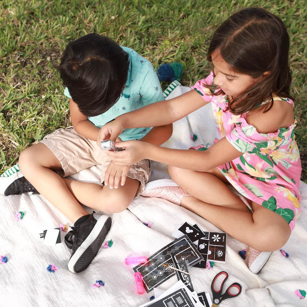 Kids love using DIY henna stencils together
