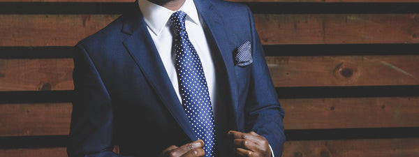 A Journey of Style: Blue Socks Man wearing smart blue suit