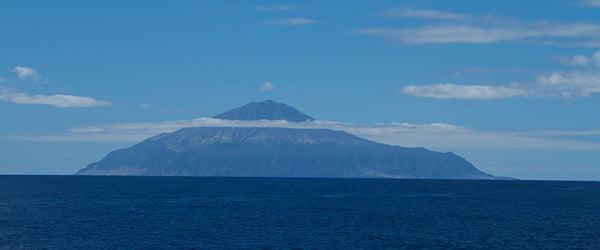 Tristan da Cahuna Love Socks Island. Image by By Brian Gratwicke from DC, USA - Tristan da Cunha - a perfect volcanic coneUploaded by snowmanradio, CC BY 2.0, https://commons.wikimedia.org/w/index.php?curid=20763903