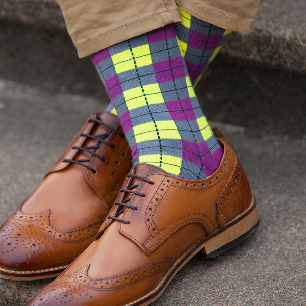 Man with brown shoes and trousers wearing Peper Harow neon Checkmate luxury socks