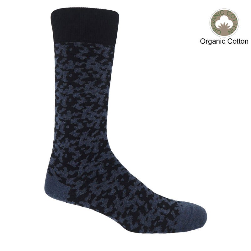 Maelstrom black men's luxury socks by Peper Harow, featuring a quirky navy pattern and navy toe and heel.