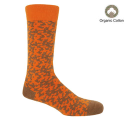 Maelstrom orange men's luxury socks by Peper Harow, featuring a quirky brown pattern and brown toe and heel.