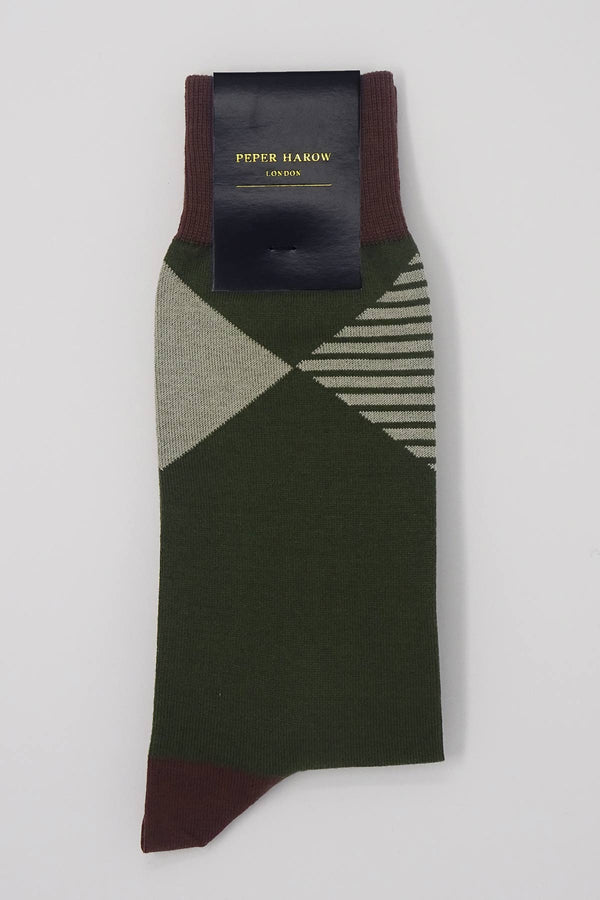 Green socks with a brown cuff, heel and toe, with a grey diamond shaped pattern around the ankle in packaging