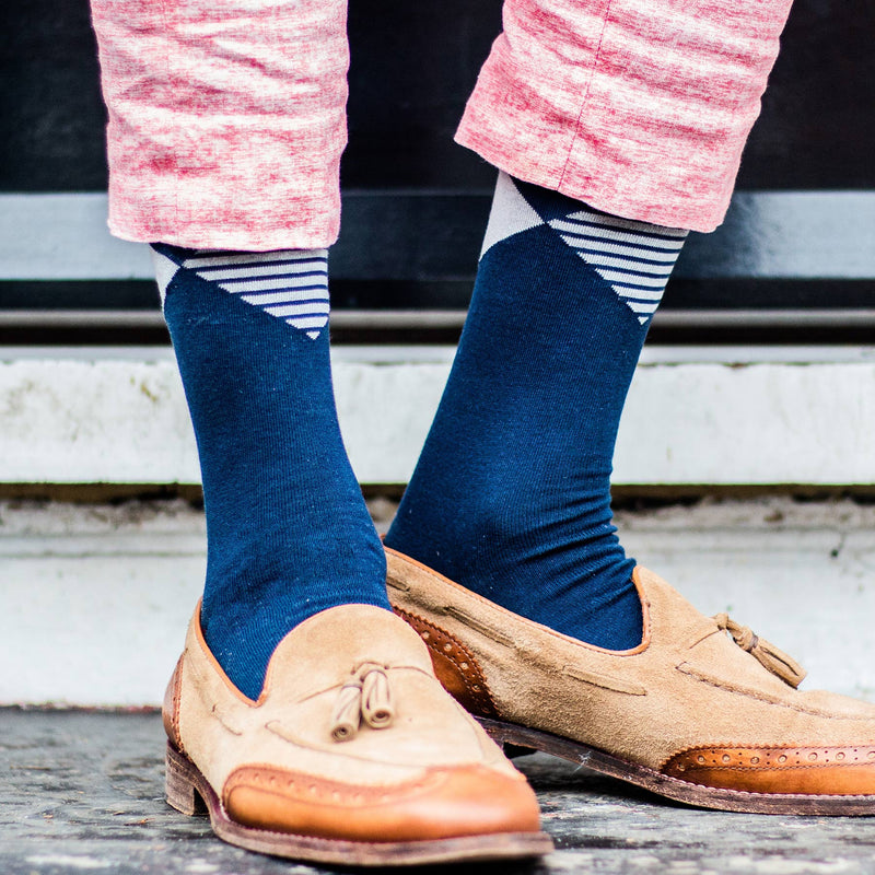 Man wearing Navy Big Diamond socks, pink trousers and leather loafer shoes.