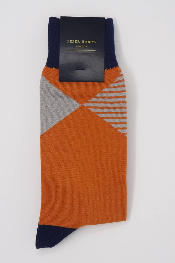 Navy socks with a red cuff, heel and toe, with a grey diamond shaped pattern around the ankle in packaging.