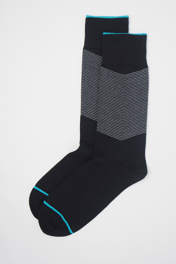 A pair of Onyx men's chevron socks, with a white V striped pattern down the calf, and a turquoise line circling the toes and the top of the cuff