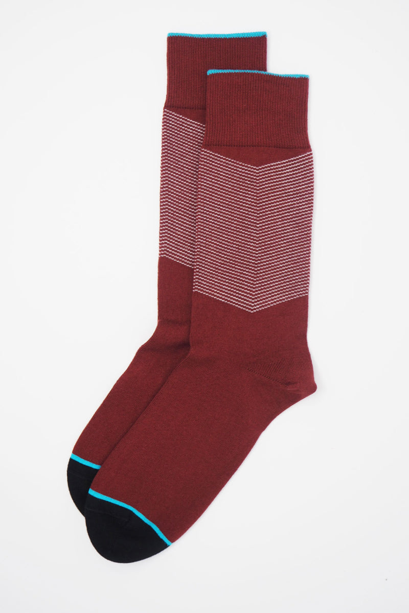 A pair of Garnet men's chevron socks, with a white V striped pattern down the calf, and a turquoise line circling the toes and the top of the cuff