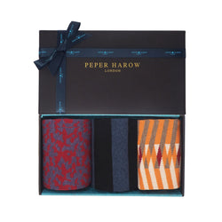 Organic men's gift box by Peper Harow containing Red Maelstrom organic socks, Black Equilibrium men's organic cotton socks and orange Symmetry men's organic cotton socks