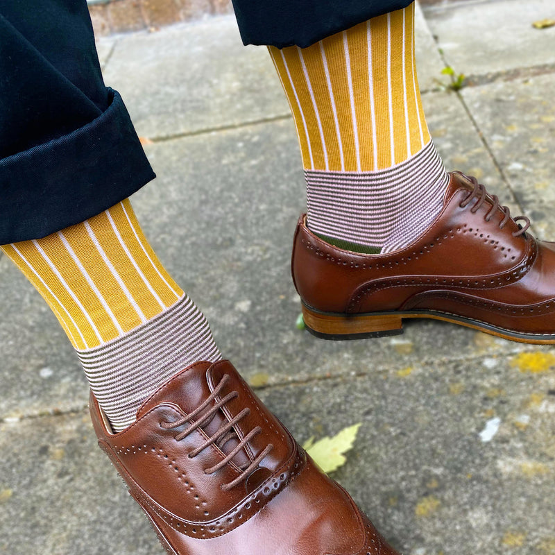 Man in brown brogues wearing Peper Harow mustard Oxford stripe socks