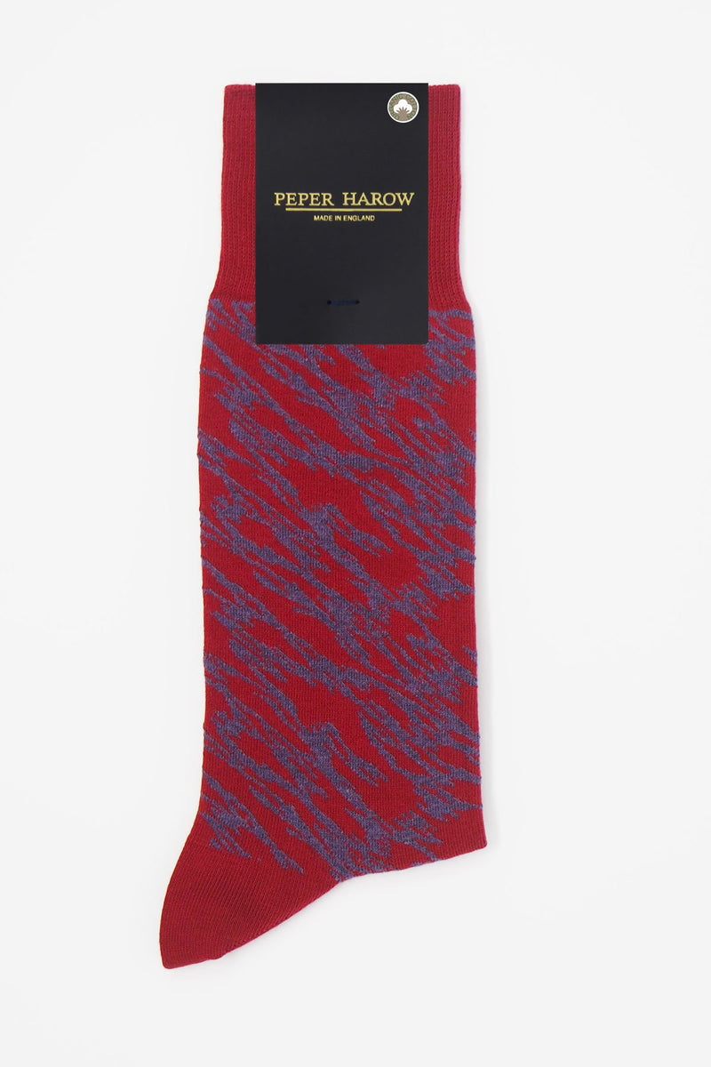 Pandemonium red men's luxury socks by Peper Harow, featuring a quirky purple pattern and purple toe and heel in packaging.