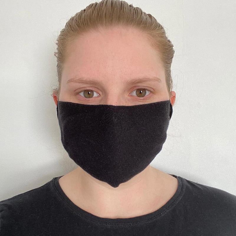 Woman wearing Peper Harow women's black washable face mask seen from the front