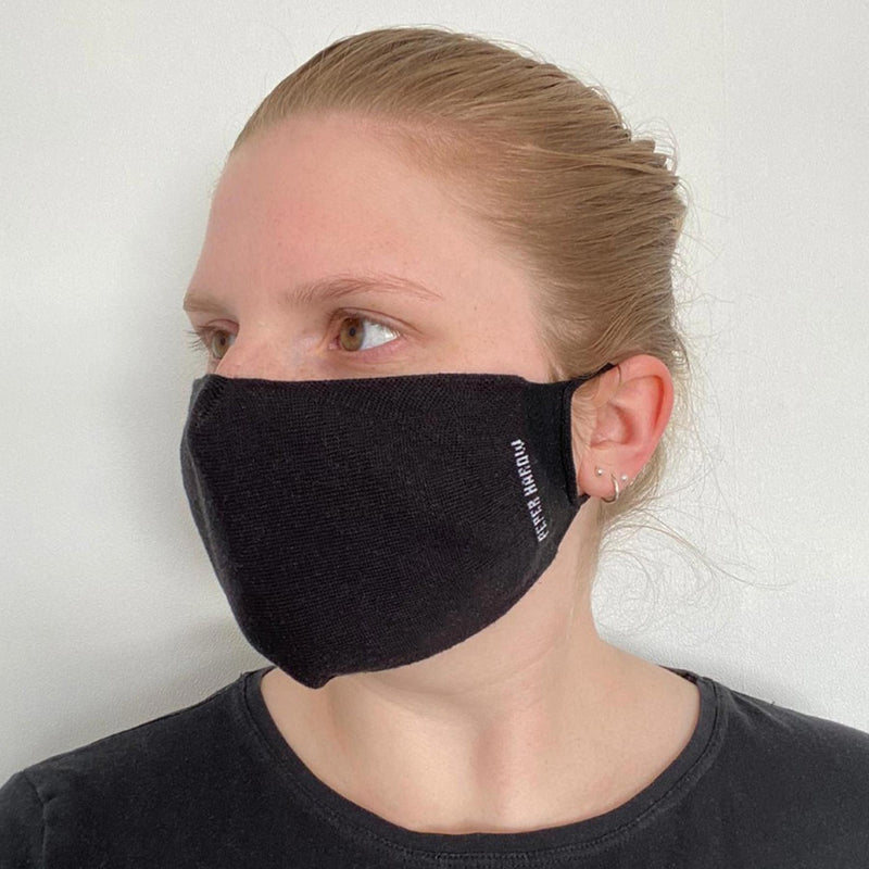 Woman wearing Peper Harow women's black washable face mask seen from the right