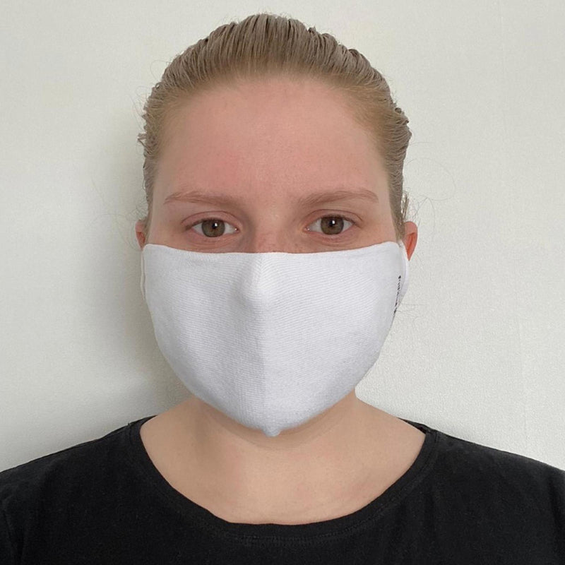 Woman wearing Peper Harow women's white washable face mask seen from the front