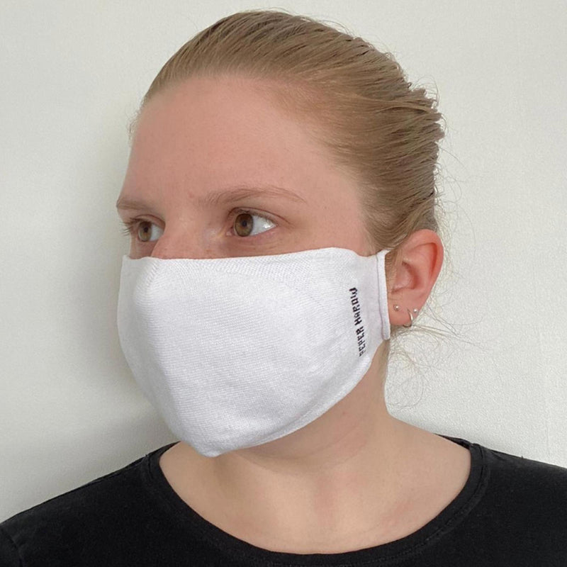 Woman wearing Peper Harow women's white washable face mask seen from the Right