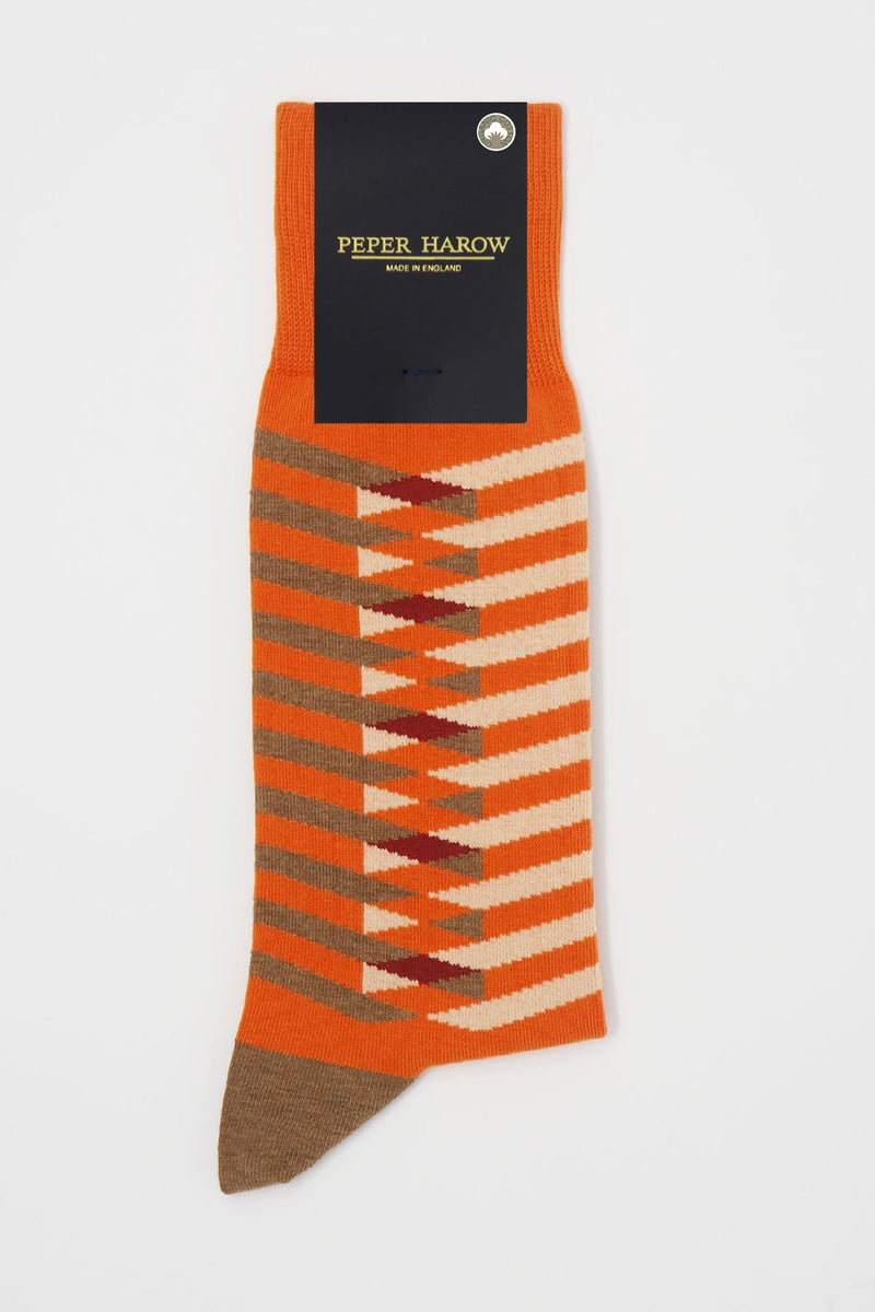 Symmetry orange men's luxury socks by Peper Harow, featuring stylish brown and white stripes, and a brown heel and toe in packaging.