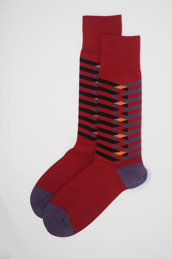 A pair of Symmetry red men's luxury socks by Peper Harow, featuring stylish purple and black stripes, and a purple heel and toe.
