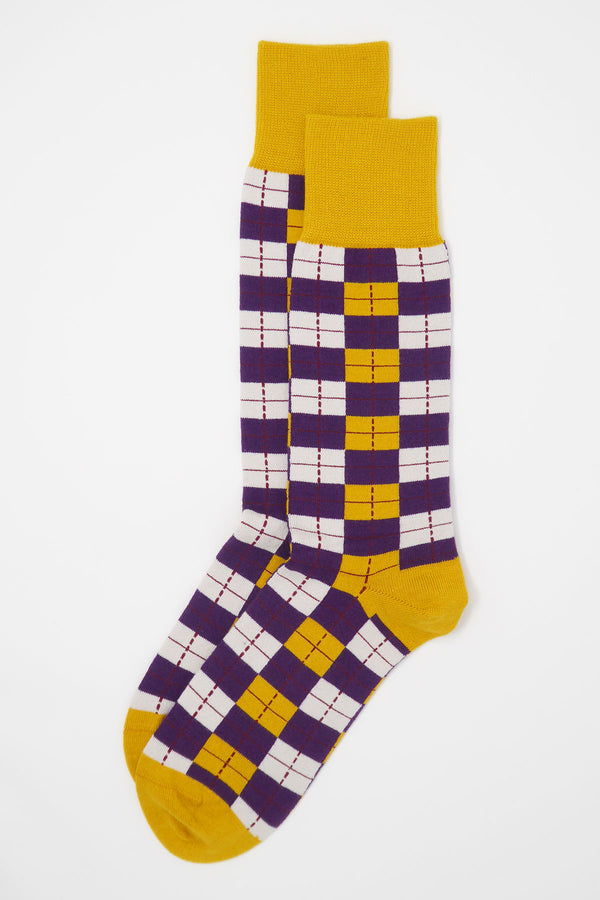 Top shot of two Peper Harow gold checkmate men's luxury socks