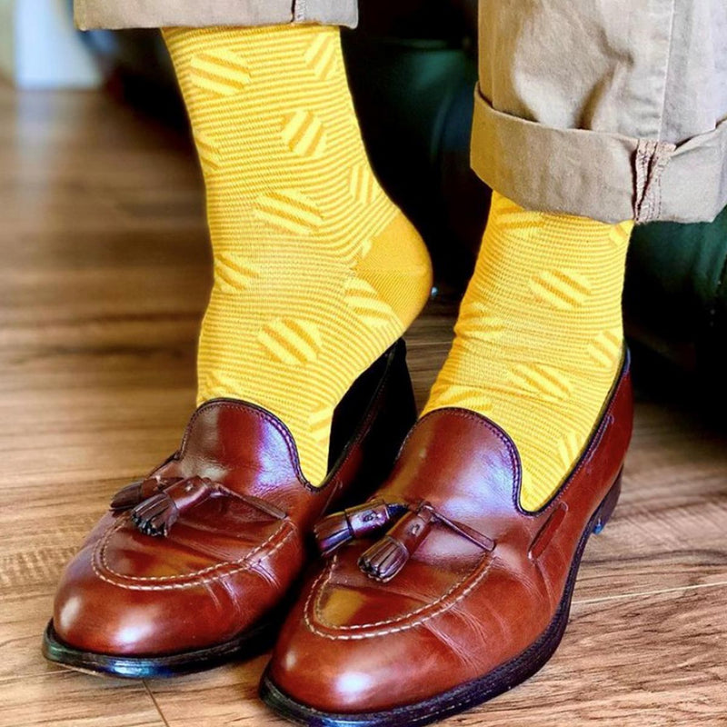 Smart man wearing tan shoes and trousers and Peper Harow butterscotch Polka Stripe mens luxury socks