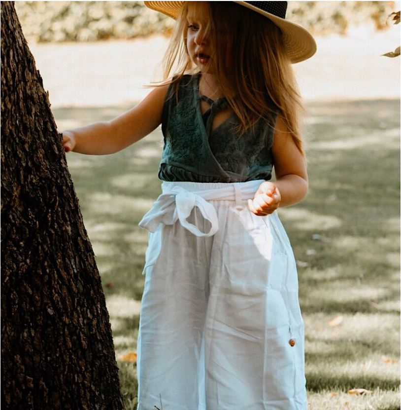 100% Organic Linen, high waisted full length pants with a bow belt. These pants also have a garter (button) on the leg so they can be rolled up to culotte length.