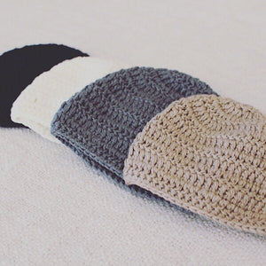 Soft 100% organic bamboo beanies are hand crocheted and are as soft as the clouds.