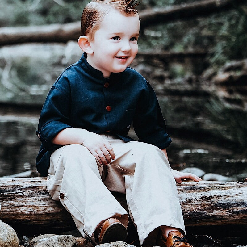 Our linen chinos are wardrobe staple and are made of the highest quality linen we can find (trust us, that's a lot of linen hunting), these chinos feature an adjustable elasticized waist and a garter so they can be rolled up for adventurous toddlers.