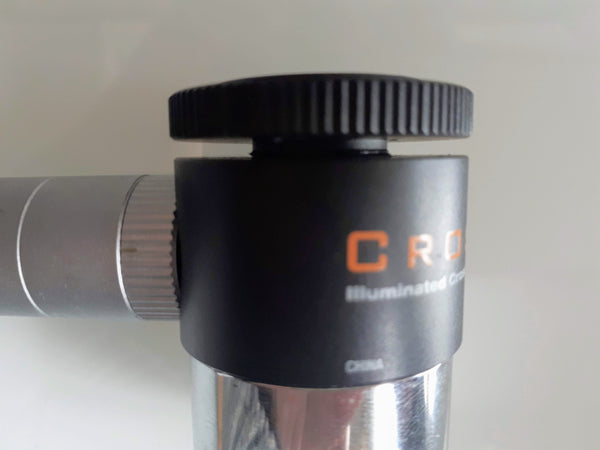 CrossAim eyepiece showing illuminator attached and knurled focus ring