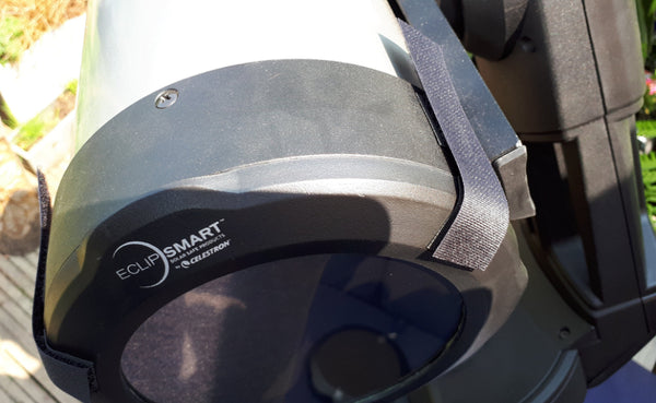 Velcro strap attached to the pair of Velcro pads on one side of the telescope