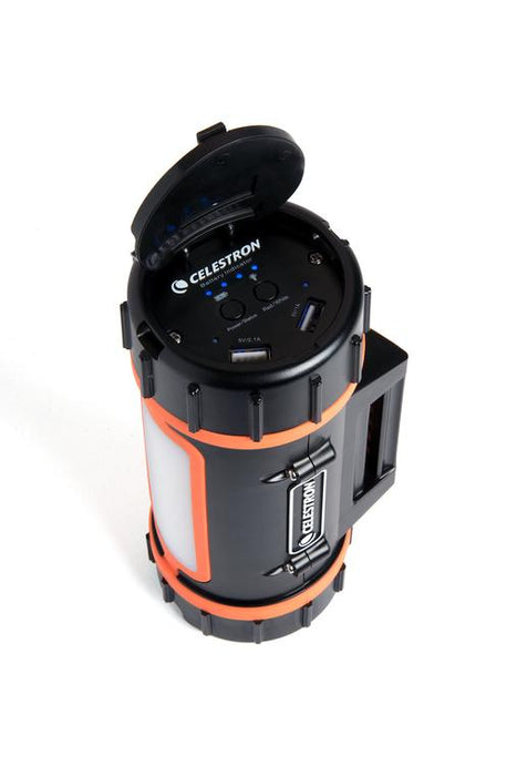 Celestron PowerTank Lithium - with cap open showing USB ports and power level lights