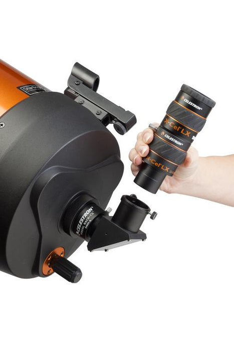 "Celestron X-Cel LX 1.25"" Barlow Lenses - being inserted into a telescope with an eyepiece"