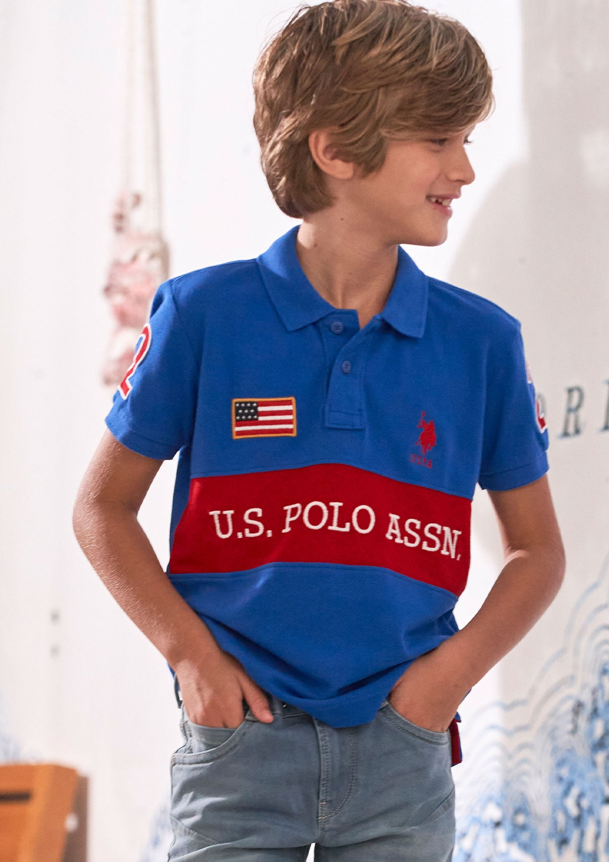 Boy in polo shirt