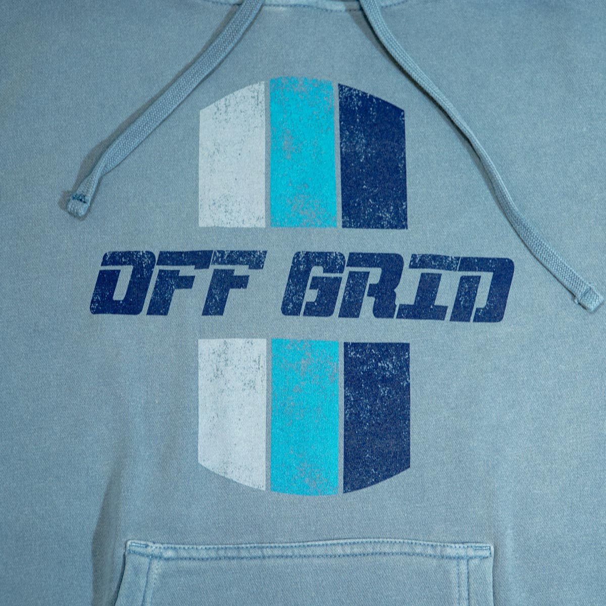 The original blue Off Grid hoodie with logo.