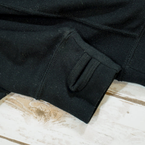 Image of Black Off Grid hoodie with thumb sleeves.
