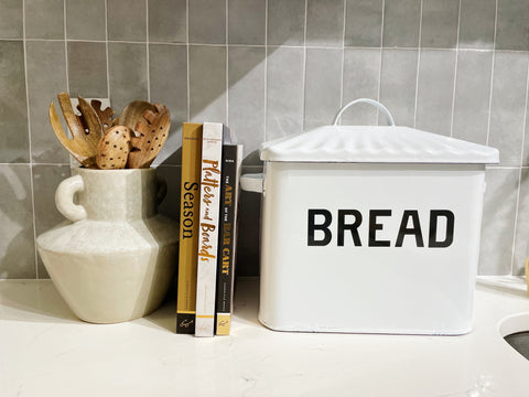 Kitchen countertop with Bread box, vase and books