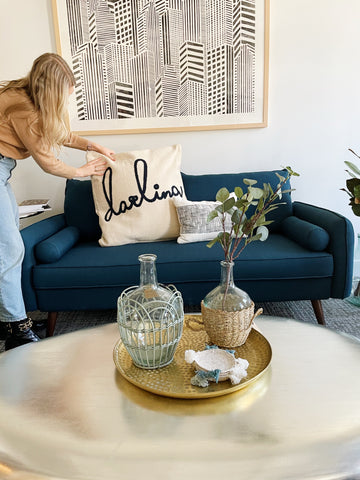 Woman sprucing up pillow