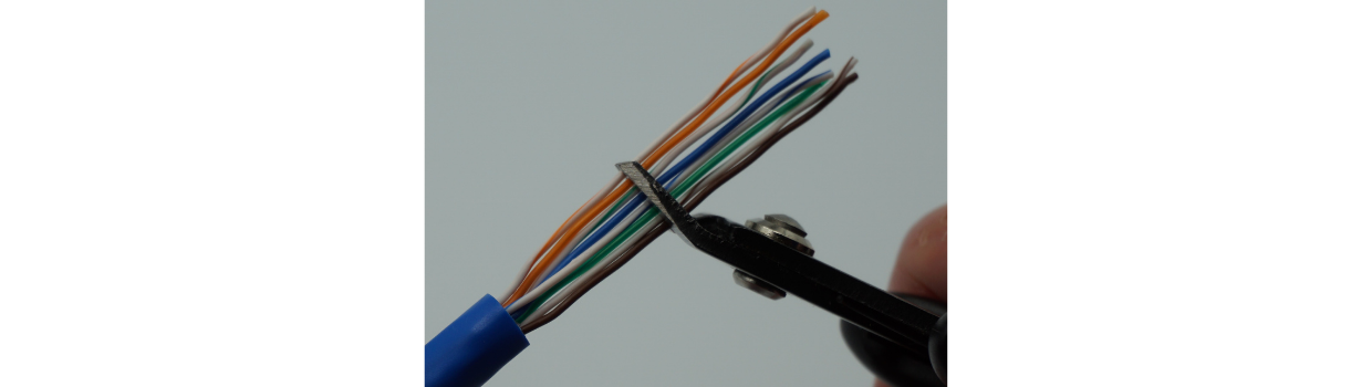 """Flush cut straight across.  Leave about 1"""" or so of conductor left.  Notice how neat and organized the conductors are at the cable jacket edge?  Yeah, you want it like that."""