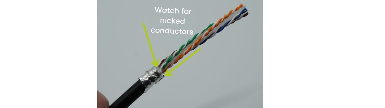 Fold the cable shield backwards over the cable jacket.  Wrap the drain wire around the shield.