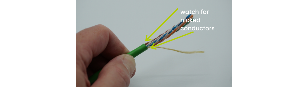 Inspect for conductor nicks at the cable jacket edge.