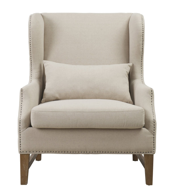 Devon Beige Linen Wing Chair from the Devon Collection  made from Linen in Beige featuring Comfortable beige linen wing chair and Approximately 400 hand-applied antique shoe nail head trim