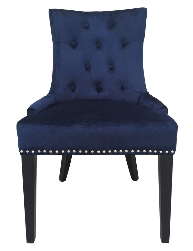 "Uptown Navy Velvet Dining Chair from the Uptown Collection  made from Velvet in Navy featuring Hand-applied silver nail head trim and a 3.5"" handle on the back and Comfortable navy velvet upholstery"