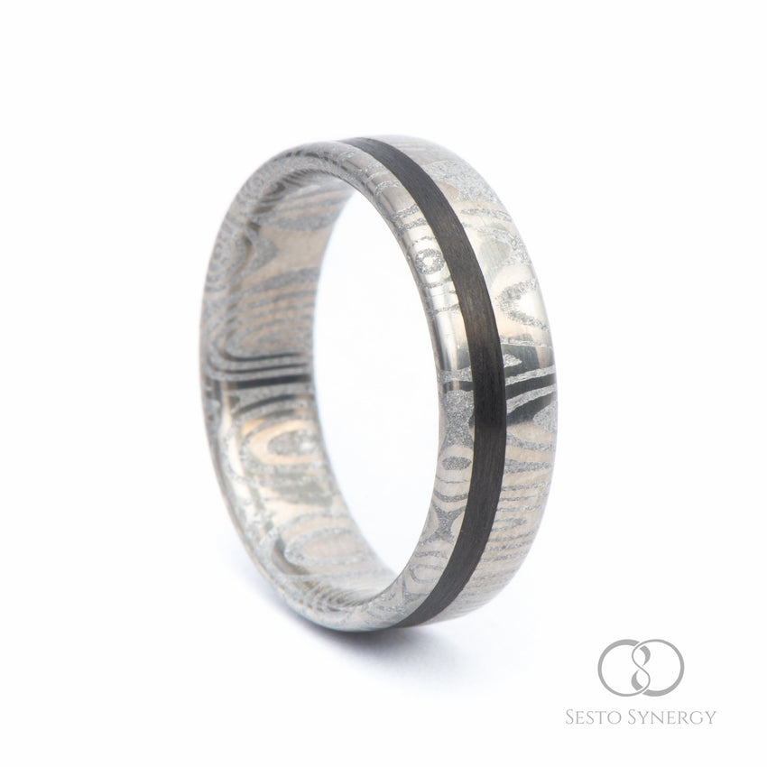 Damascus Ring with Off-Center Unidirectional Carbon Fiber Inlay • Frenja Pattern