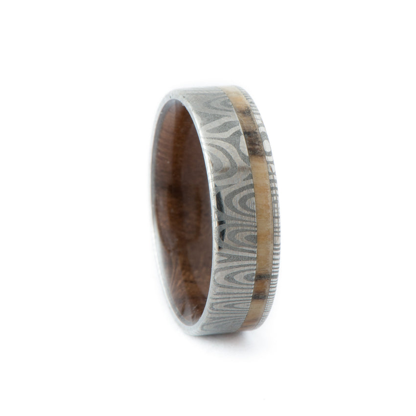 Damascus Ring with Off-Center Silver Birch Wood Inlay & Walnut Wood Inner Sleeve • Frenja Pattern