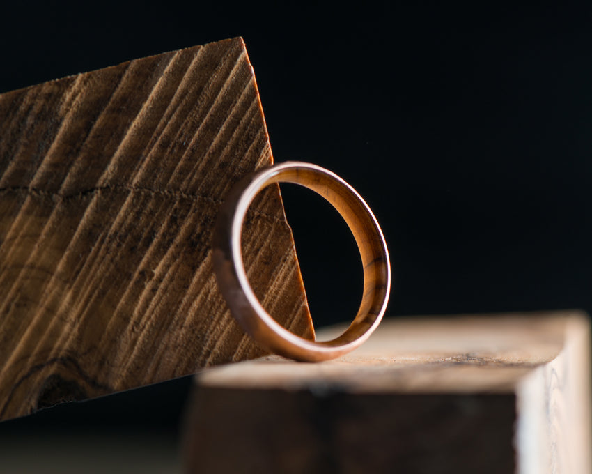 14K Gold Rose Ring with Olive Wood Inner Sleeve • Facet Finish