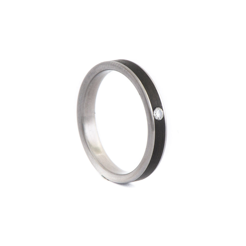 Titanium Ring with Central Unidirectional Carbon Fiber Inlay & Centered Diamond 0.03 ct.