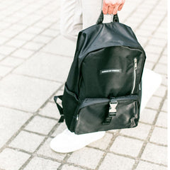 Black Pardon My French backpack, made from 100% polyester, featuring a silver zip and buckle.