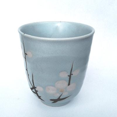 Japanese Tea Cup with White Cherry Blossoms on a blue cup