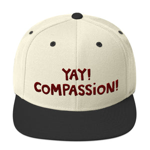 YAY! COMPASSION! Snapback Hat with maroon embroidered lettering