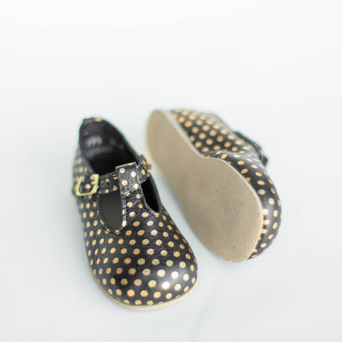 black t strap with gold polka dots