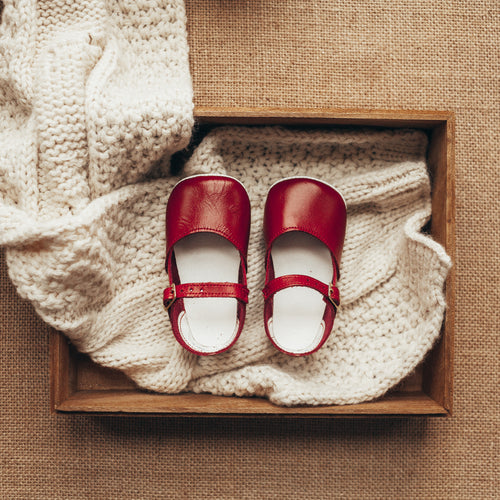 red leather crib shoes, beige sole, single strap
